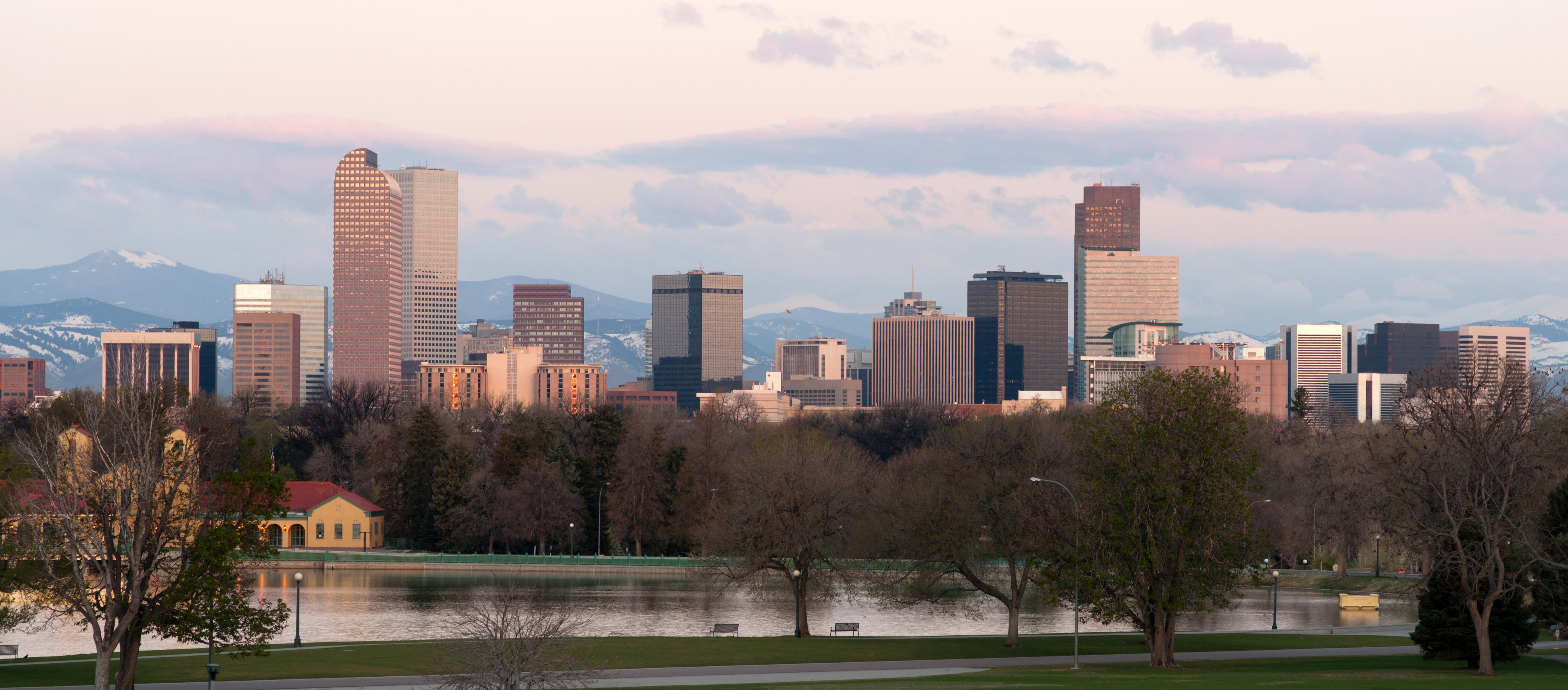The Rocky Mountains stand behind Denver at sunrise